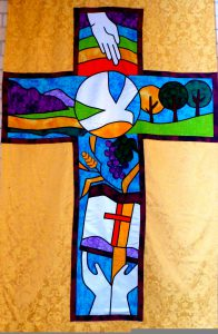 Handmade banner featuring a cross, dove and bible.